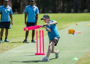 child playing cricket